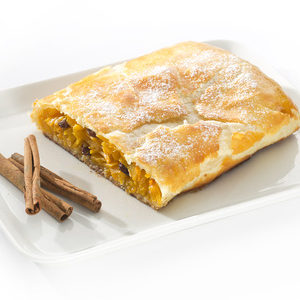 43527206 - pumpkin strudel on a plate on a table with a cinnamon